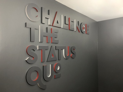 Challenge the Status Quo ligatures letters typography wall art mission tinkering monkey signage