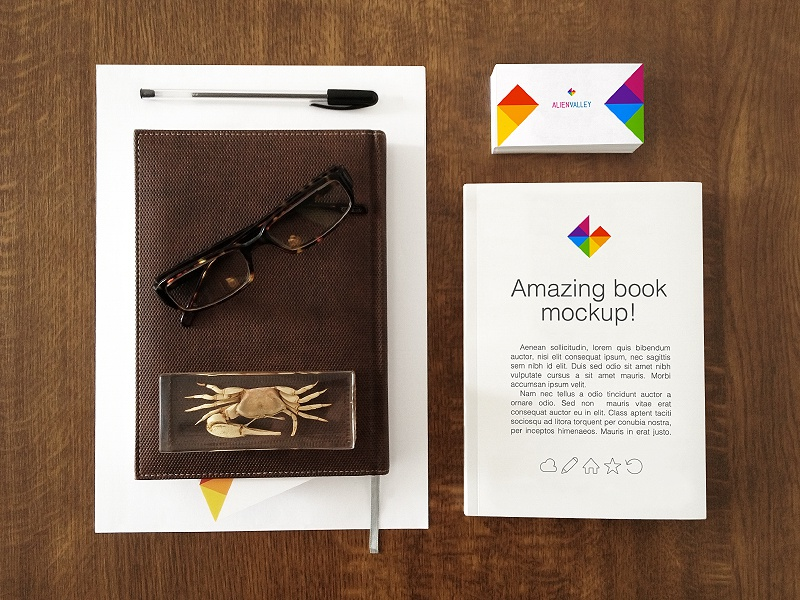 Business Card and Book Free Mockup business card book mockup free pen glasses crab