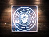 Pine Lodge Inn Sign