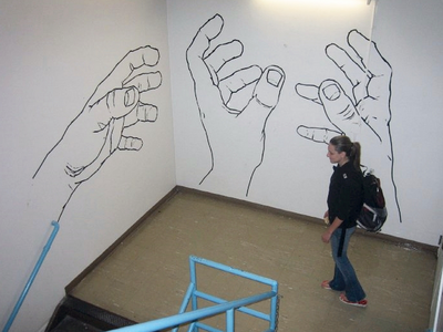 Stairwell tape murals freehand hands tape mural