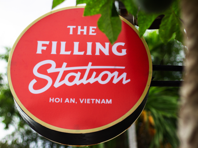 the filling station circle sign american food hoi an vietnam restaurant identity logo sign station filling