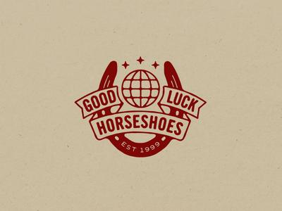 Good Luck  good luck mark logo globe horseshoe