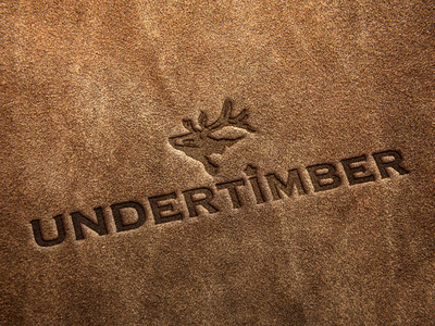 Undertimber logo on leather bear illustration minimal leather mockup modern illustration branding nature forest animal logo bear logo bear
