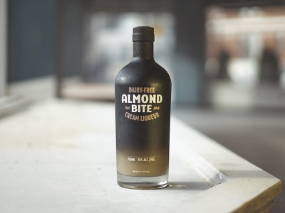 New Almond Bite Bottle design product liqueur products branding typography retro customtype typedesign black type vintage product design