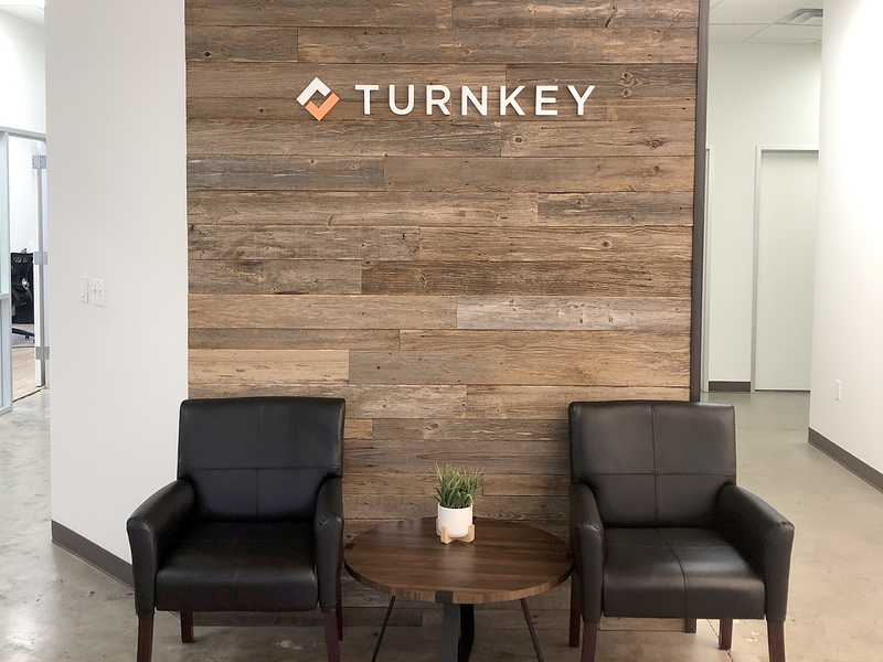 TurnKey Logo Wall at Austin, TX Headquarters branding interior design interior design logo