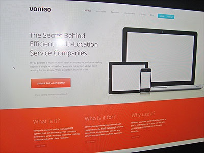 Vonigo Home Page ui ux home page landing page orange black blue grey banner ipad iphone landing page