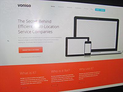 Vonigo Home Page ui ux home page landing page orange black blue grey banner ipad iphone landing page