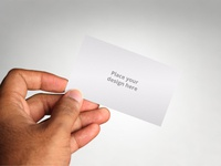 Realistic Business Card in Hand Mockup