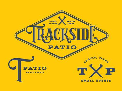 Trackside Patio badge texas train lockup branding