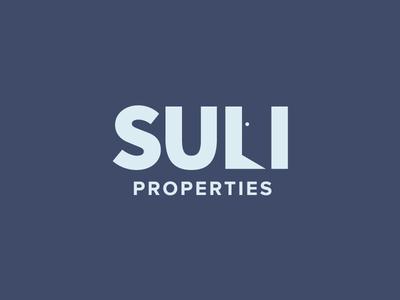 SULI property development dark branding door negative property development logo