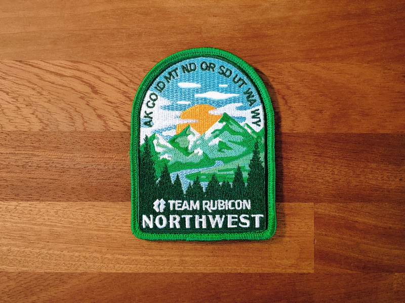 NW Territory Badge branding illustration sewn pine trees sun mountains green team rubicon northwest patch badge production