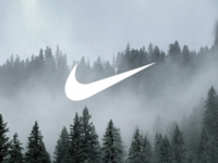 What does the Nike symbol means and who designed it?