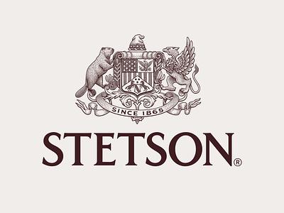 Stetson filagree banner sheild beaver griffen pen and ink scratchboard engraving heraldic heraldry mark branding logo seal crests crest logo crest