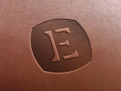 The Em Boss monogram brand mark branding agency jam session focus lab leather embossed e monogram brand identity branding design branding