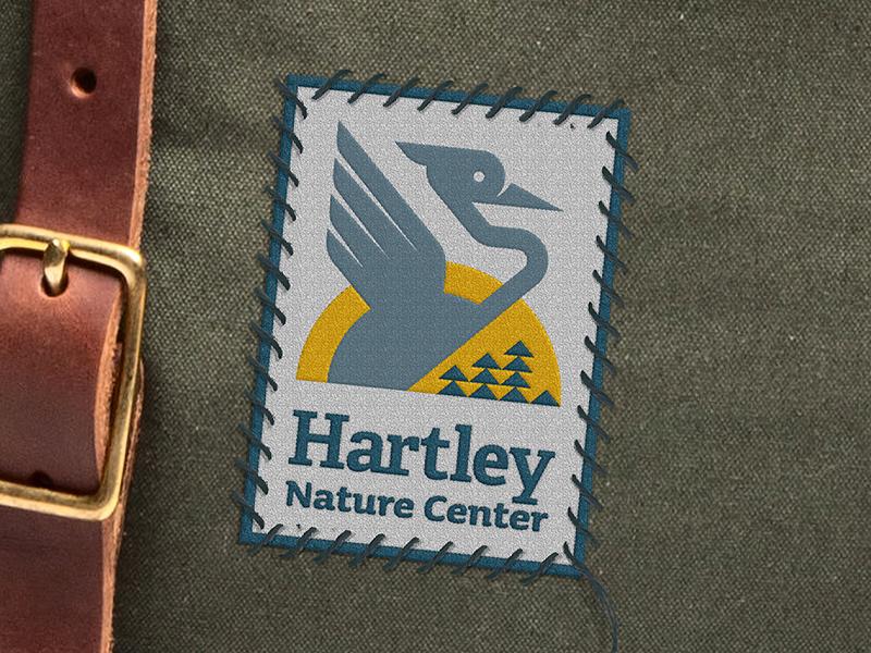 Hartley Nature Center Rebrand sun trees nature illustration bird blue heron logo