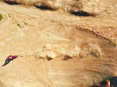 FMX Stunt Landing still movie drone dust sand stunt motocross freestyle fmx
