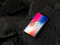 Iphone x on rocks mockup by anthony boyd graphics  2