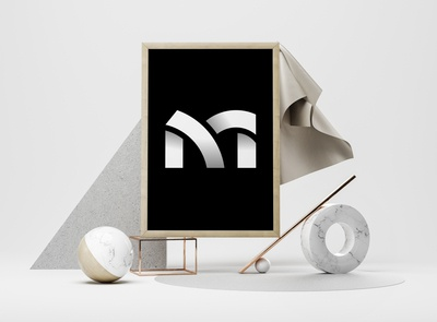 "Geometric lowercase ""m"" letterform"