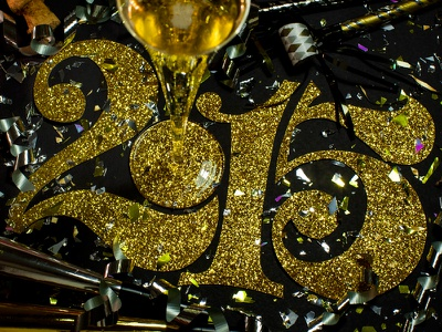 Happy New Year! lettering cut paper numerals numbers glitter confetti metallic gold black serif curves and