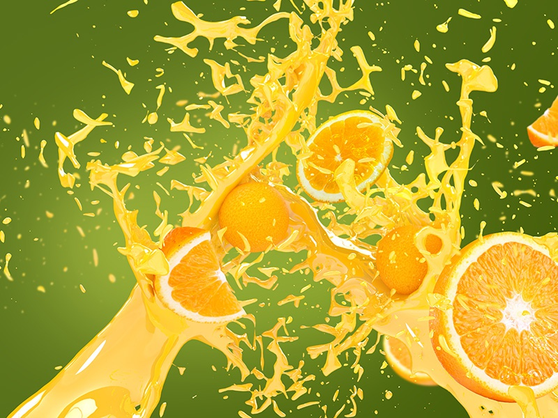 oranges in juice splash over green and yellow background