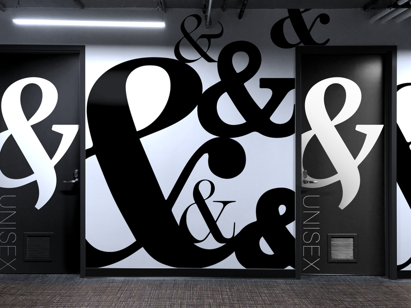 Office Interior Wall with Gender Neutral Restrooms office space bathroom restroom unisex gender design ampersand typography monochromatic wall art interior design