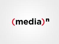 (media)n Logo