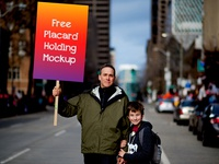 Free Placard Holding Mockup