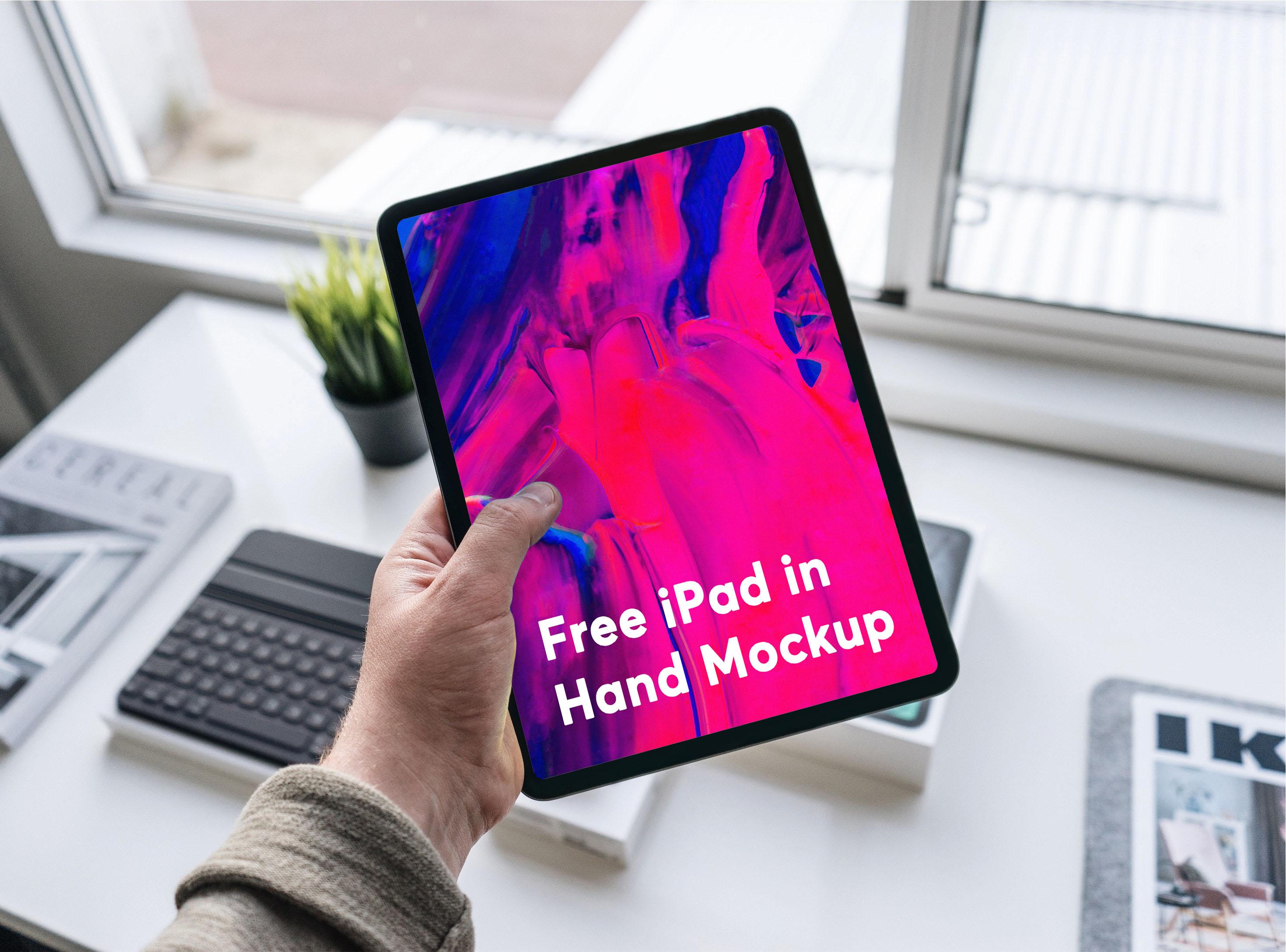 Free ipad in hand mockup