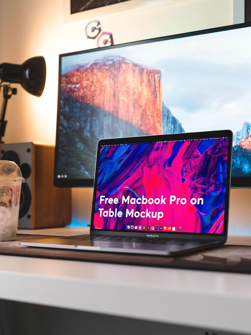 Free macbook pro on table mockup