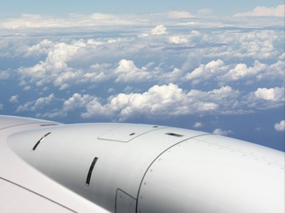 Coming Home plane clouds flight united engine wing