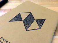NewsCred logo rubber stamp