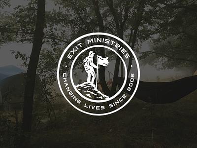 Exit Ministries Logo circle man logo camping backpack rock climbing woods flag mountain hike extreme