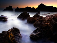 Ocean Mist Through Rocks