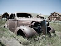 Old car in a farm field