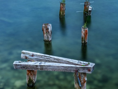 Broken-down Pier In Shallow Water