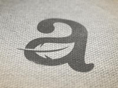 A logo logo a feather texture