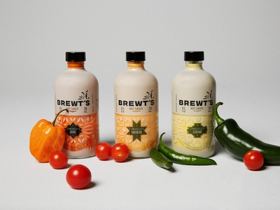 BREWT'S Hot Sauces peppers food hispanic logo design rebrand spicy chihuahua bottle pattern dog logo dog hot sauce packaging packaging design logo full circle branding design art direction