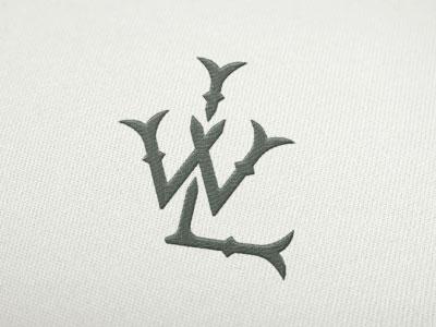 WL Monogram serif bifurcated colonial lettering hand monogram