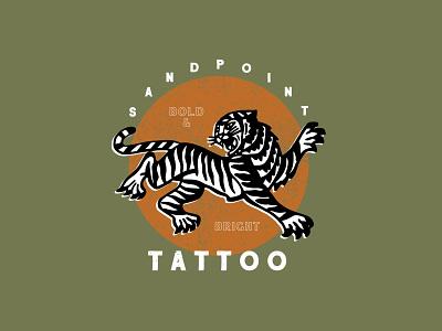 Sandpoint Tattoo bright bold sandpoint tattoo brand tattoo shop branding tiger illustration illustration orange green tattoo tiger sign design brand design identity brand